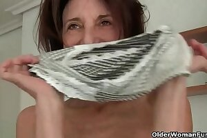 Euro gilf Koko lowers her jeans together with rubs her pussy