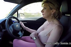 Mature blonde Laddie Sonia plays in will not hear of tits while driving